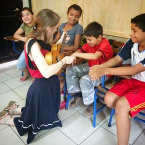 Katie teaching ukulele to Nicaraguan children